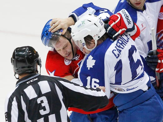 Rochester's Kevin Porter, left, tries to spark his team and the fans during a scrap with Toronto's Sam Carrick during the Marlies' 4-2 win Friday at Blue Cross Arena.