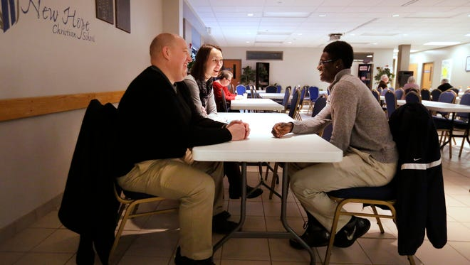Messiah Morning, the Boys and Girls Club Youth of the Year for 2015,  talks with Hans and Mari Nelson at New Hope Lutheran Church before leaving for an early basketball practice at Menasha High School.