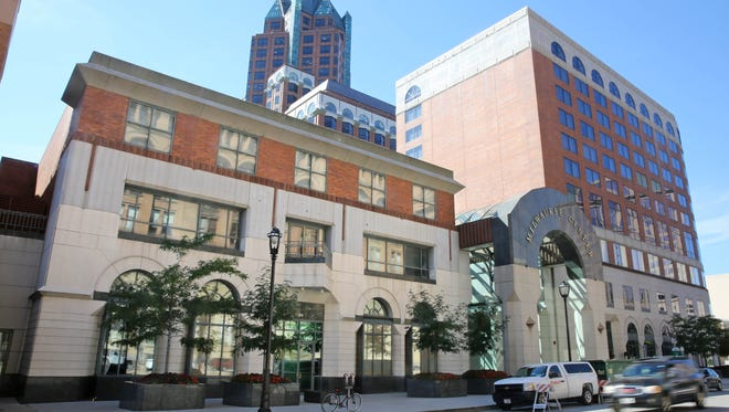 Downtown Milwaukee's InterContinental Hotel (right) is being rebranded as an independent hotel with an arts focus.