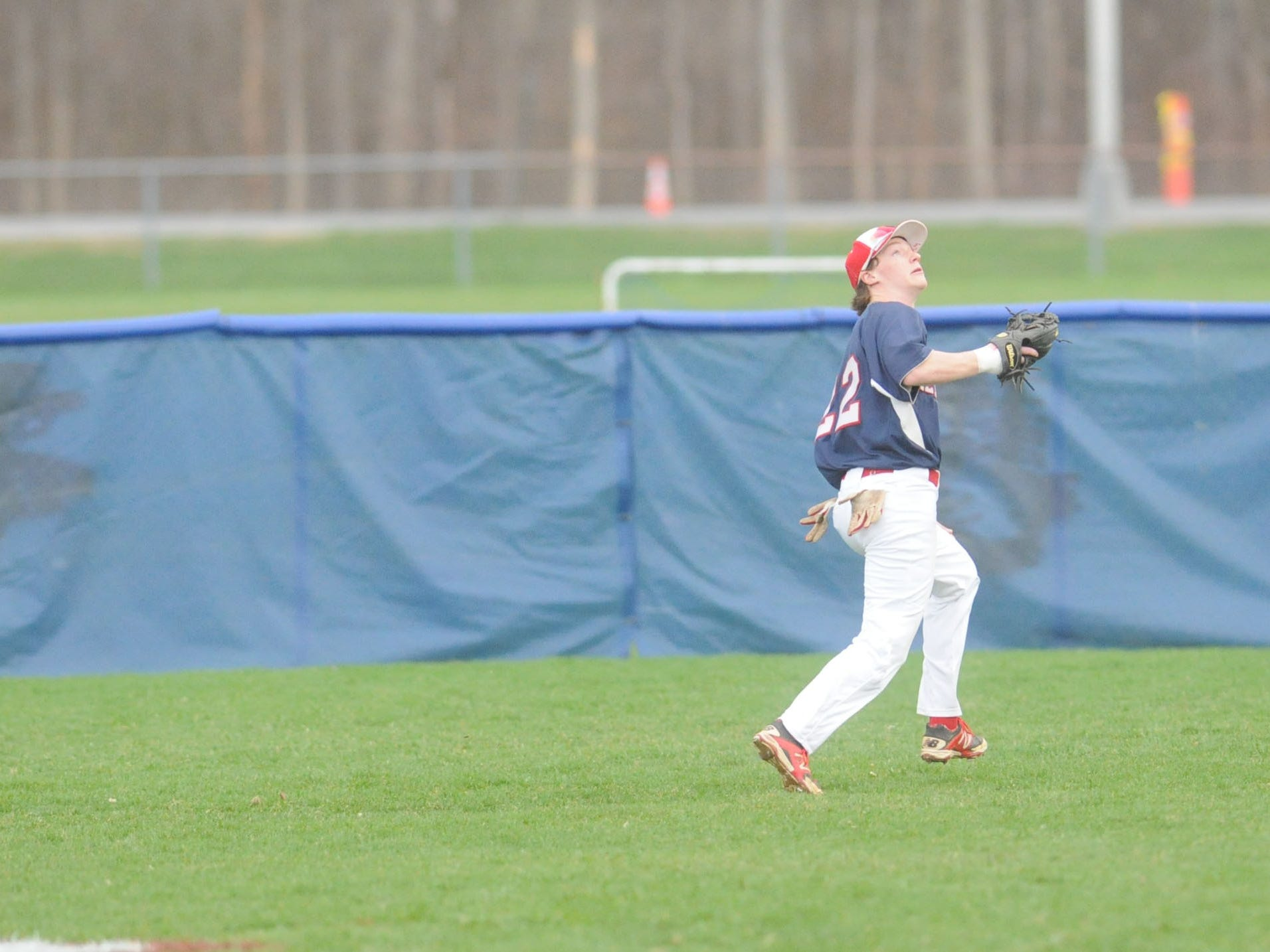Ketcham's Nicholas Shepheard goes to make a catch in centerfield in Friday's game against Arlington.