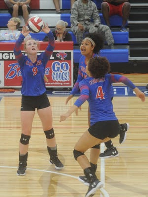 Cooper's Caylee Collier, left, sets the ball while Alexis Garcia (4) and Jada Willis look on in their match against Midland Lee. Lee won the nondistrict match 25-17, 25-19, 16-24 Tuesday, Aug. 22, 2017 at Cougar Gym.
