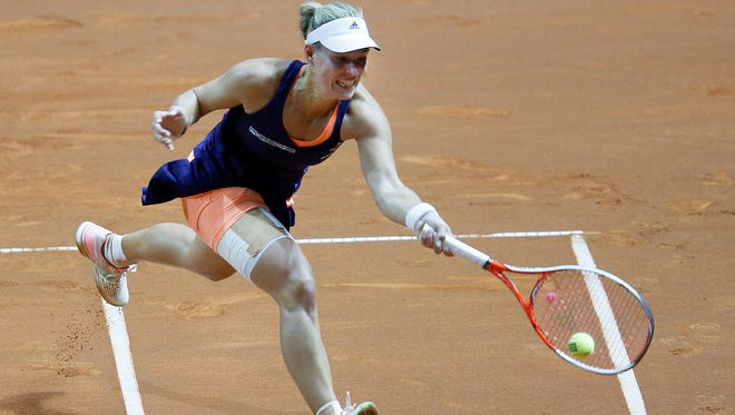 Germany's Angelique Kerber hits a forehand against Denmark's Caroline Wozniacki in their final match at the Porsche Grand Prix tennis tournament in Stuttgart, Germany, April 26.