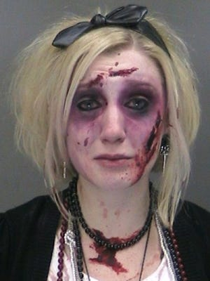"Catherine Butler of Rochester, N.Y. is seen in a booking photo provided by the Gates, N.Y., Police Department. Police say Butler, wearing a zombie costume and makeup, was charged with drunken driving twice within three hours Saturday, Oct. 25, 2014 after attending a Rochester bar's ""zombie prom"" party."