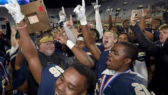 The Pearl Pirates and head coach John Perry celebrate with the Class 6A trophy after beating Starkville 21-17 on Friday, December 1, 2017, at the MHSAA Football State Championships at Vaught-Hemmingway Stadium on the University of Mississippi campus in Oxford, Miss.