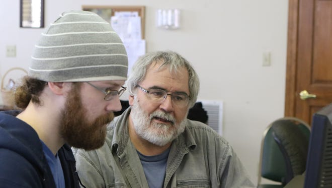 West Monroe Community Center's Coordinator of Community Outreach Kirk Norris helps Dale Kelley navigate DisasterAssistance.gov at the West Ouachita Senior Center on Saturday, March 19, 2016. Kelley was applying for FEMA aid on his parents' behalf. The senior center and community center have partnered to help people apply using the website.