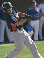Galion's Aaron Barnhart hits the ball while playing