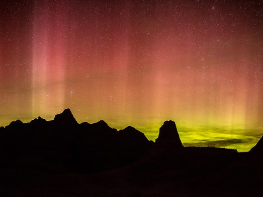 Lights from the aurora borealis dance over Badlands National Park on April 23 in South Dakota. A strong solar storm is expected to cause an expansion of the photogenic aurora borealis, or Northern Lights, across Canada and the northern U.S. on Sept. 12-13, 2014.