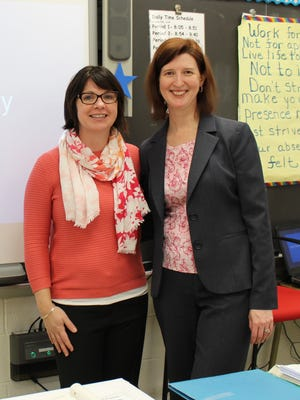 Cynthia Cassidy (L) and Lynn Alger are integration specialists at Warren Middle School, working to find common threads across grade levels and subject areas to improve instruction.