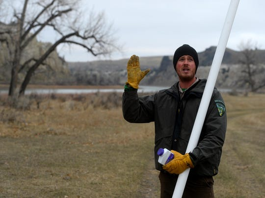 Sean Reynolds of the BLM gives an orientation talk to volunteers at the cottenwood tree planting project at the Eagle Creek Campground in the Missouri River Breaks Monument, Tuesday morning.