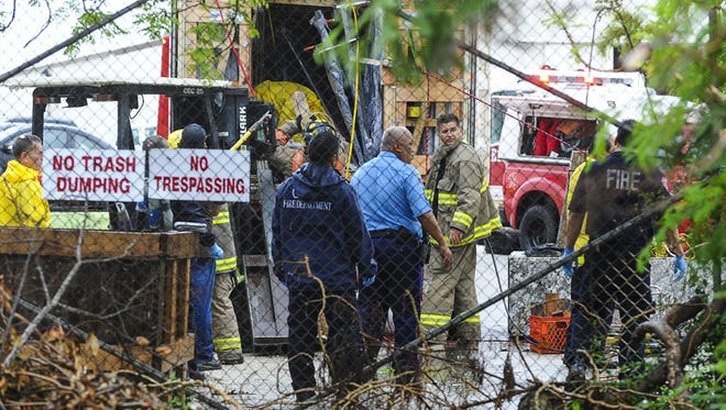 Emergency responders work to remove a victim after he was trapped under stone slabs inside a shipping container at Marmol Guam Natural Stones & Design Center in Tamuning on June 4.Rick Cruz/Pacific Daily News/rmcruz@guampdn.com