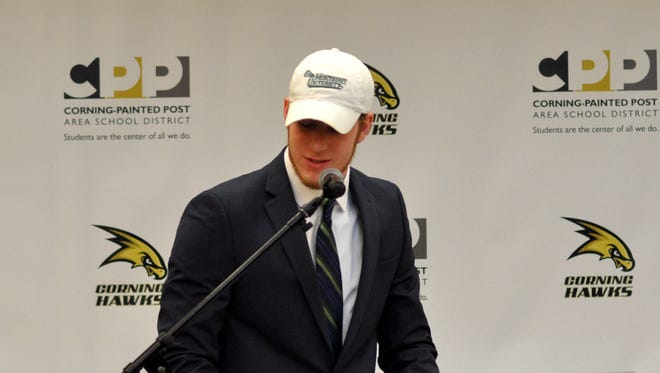 Mike Rossi talks Friday during his signing ceremony at Corning-Painted Post High School.