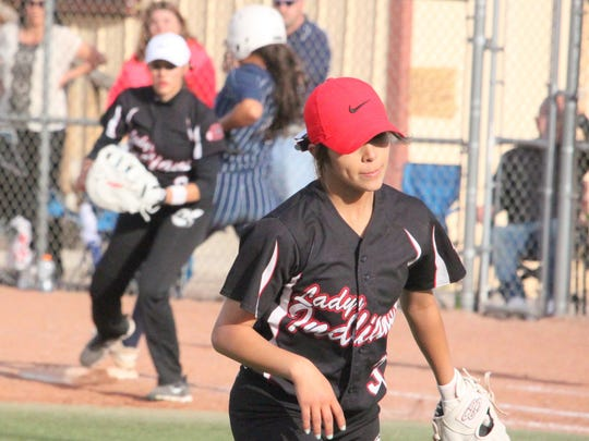 Cobre's third baseman Brianna Merino struts confidence after throwing out this Silver baserunner, as seen walking back toward the dugout before the play is even called.