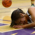 Ross' Jazmin Bulger falls hard after getting tangled up on a rebound.