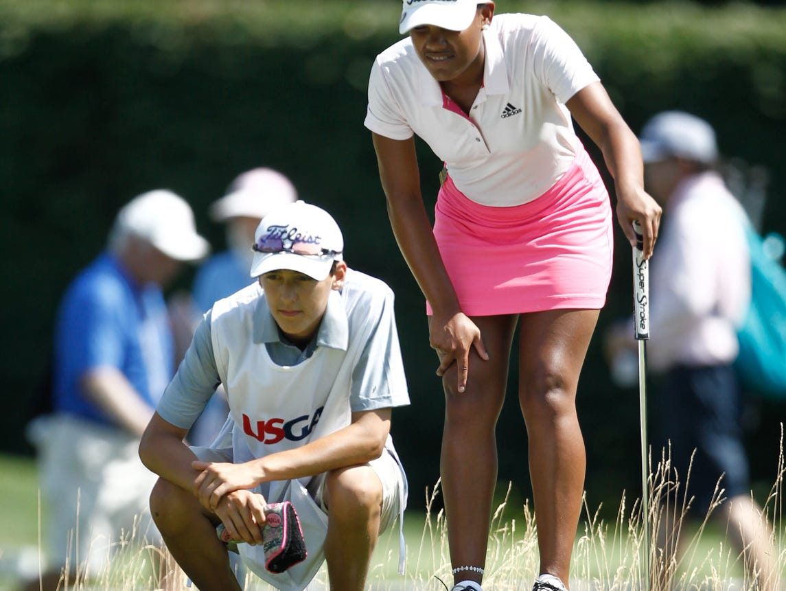 Kyra Cox, 16 from South Salem, with caddie Jacob Gonzalez, look over a putt in the 68th U. S. G. A. Girls Junior Amateur Championship at The Ridgewood Country Club in Paramus on Monday, July 18, 2016. Kyra Cox recently played in the 2016 Drive, Chip & Putt National Championship at Augusta National and was the Metropolitan PGA Player of the Year three consecutive times from 2013 to 2015.