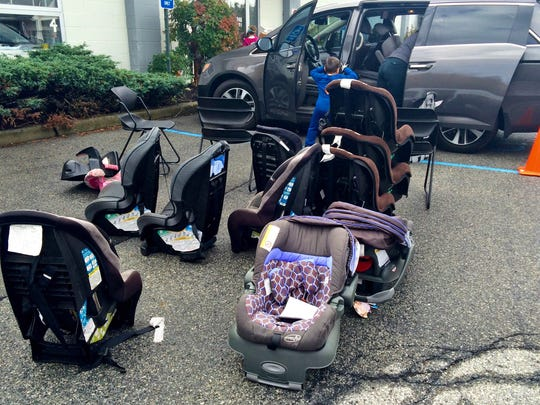 Some families received car seats Sunday as part of Health Quest's Car Seat Program.