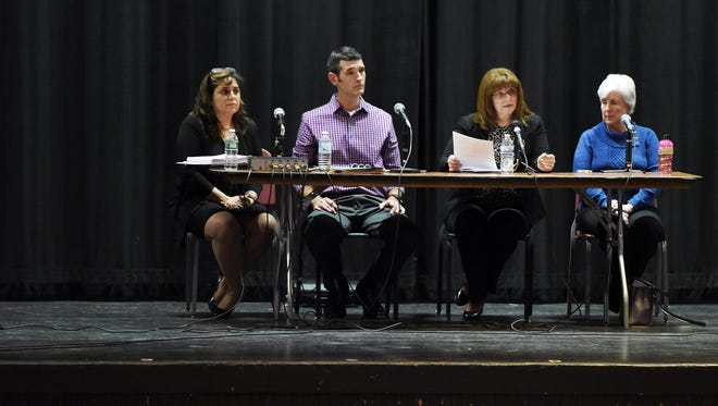 A Common Core forum is held at Roy C. Ketcham High School on Wednesday in Wappinger. Panelists, from left, are: Donna Torrisi, principal of Frank G. Lindsey Elementary School; Paul Galletta, district parent; Anne LaValle, district parent; and Peg Luksik, advocate for special education and elementary education.