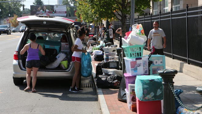 Returning students at Iona College in New Rochelle, unload their belongings along North Avenue, Aug. 20, 2016. Iona's off-campus students have been subjects of neighborhood complaints in the past.