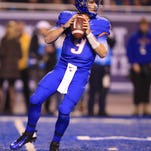 Dec 6, 2014; Boise, ID, USA; Boise State Broncos quarterback Grant Hedrick (9) looks down field for a receiver during the second half verses the Fresno State Bulldogs at Albertsons Stadium. Boise State defeats Fresno State 28-14. Mandatory Credit: Brian Losness-USA TODAY Sports