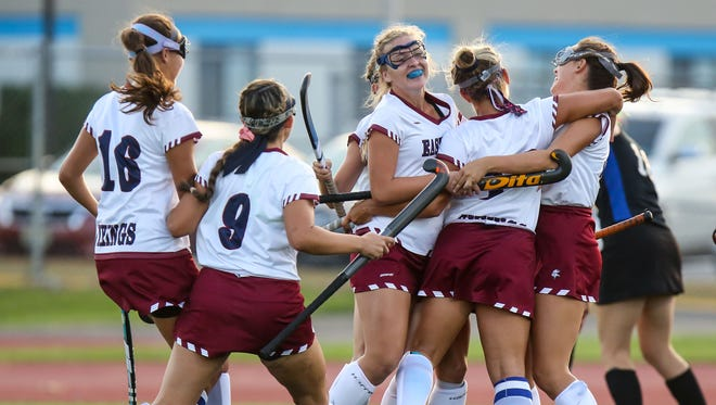Eastern players celebrate after a goal during a 6-2 triumph over Oak Knoll on Saturday.