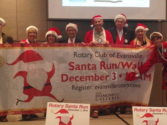 Santa Run Santa's helpers turned out in force at a recent Rotary Club of Evansville meeting to remind Rotarians of the upcoming Santa Run on Dec. 3 at 9 a.m. at the Eykamp Boy Scout Center.  The event features both a 5k run and a 1 mile family fun walk. Pointing out the website for more information -- evansvillerotary.com -- are from left Steven Keck, Amy Walker, Julie Spratt, Rob Bernardin, Ron Huffman, Paul Crimm, Kari Aiken, Pepper Mulherin and Cathy Renner.