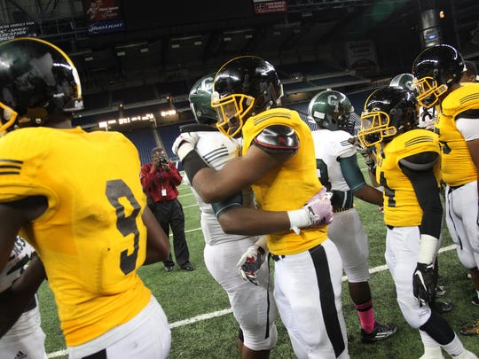 Detroit Cass Tech and King shakes hands after King's 27-25 win over Cass Tech in the Detroit PSL Division I football title game at Ford Field on Friday.