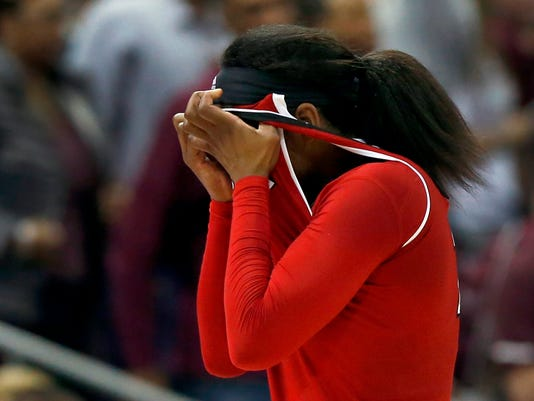 Louisville's Myisha Hines-Allen (2) wipes her face after fouling out during overtime against Mississippi State in the semifinals of the women's NCAA Final Four college basketball tournament, Friday, March 30, 2018, in Columbus, Ohio. Mississippi State won 73-63. (AP Photo/Ron Schwane)