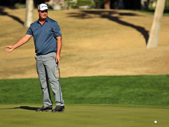Michael Putnam reacts after watching his birdie putt go just past the cup on the eighth green at the Palmer Private Course at PGA West during the second round of the Humana Challenge on Friday, January 23, 2015 in La Quinta, Calif. Putnam finished -5 on the day and -14 on the tournament.