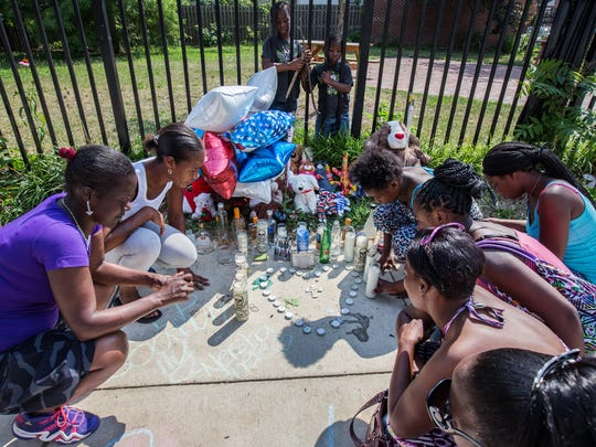 Family members light candles at a vigil for Otis Saunders killed July 9 near E. 22nd and Lamotte streets in Wilmington. FBI statistics show the city's rate of violence is more than quadruple the U.S. average.