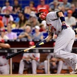 St. Louis Cardinals catcher Yadier Molina takes off for first base as he hits a double during the second inning against the Miami Marlins on Thursday.
