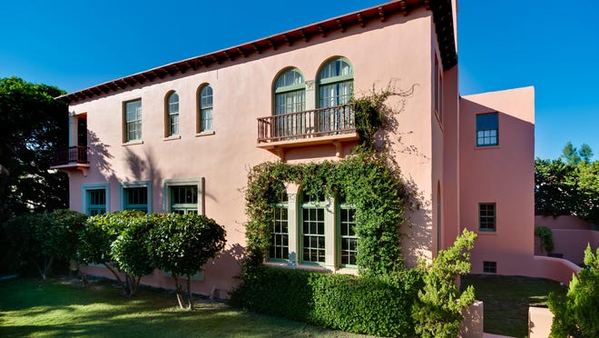 Benjamin and Elys Wohl replicated Mizner's original pink paint for the exterior of 111 Dunbar Road, which the couple just sold for a recorded $8.04 million. The Wohls moved and restored the house.