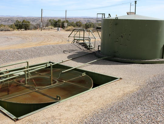 An XTO Energy natural gas well facility near Piedra Vista High School in Farmington operates in March 2016.