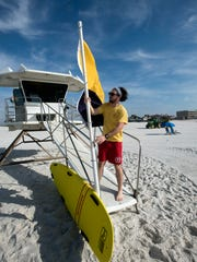 Pensacola Beach lifeguard Alex Morris sets-up tower No. 3 in March 2018.