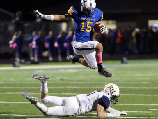 Mukwonago junior Jake Schierts hurdles over the Kettle