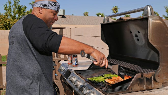 "Phil ""Phil the Grill"" Johnson in his backyard in Phoenix."