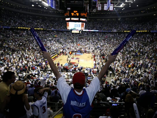 Fans erupt with joy during the fourth quarter of Game