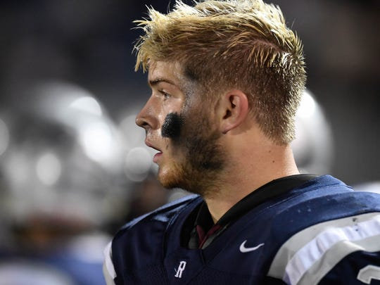 Reitz's Jackson Ashby watches action on the field as the Evansville Reitz Panthers play the East Central Trojans in the 4A regional at the Reitz Bowl Saturday, November 12, 2016.