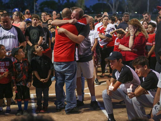 More than 100 people come together to remember 13-year-old Jarrod Dougherty who played youth baseball for the Bombers during a vigil at Demuth Park in Palm Springs, May 8. 2017.