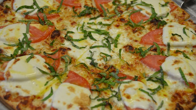 The Mediterranean pizza at Fox's Pizza Den, located in the Harris Teeter shopping center in Selbyville, is made with fresh Mozzarella, tomato and basil.
