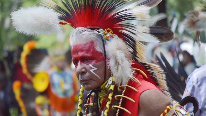 """Apesanahkwat of the Memominee Tribe of Wisconsin dances in the Grand Entry procession of Native American dancers at the 19th Annual Tunica-Biloxi Pow Wow Saturday, May 17, 2014 at the Chief Joseph """"Alcide"""" Pierite Pow Wow Grounds in Marksville."""