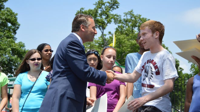 County Executive Rob Astorino presented students who maintained above a 3.8 GPA or had perfect attendance last year with free season passes to Rye Playland on Tuesday.
