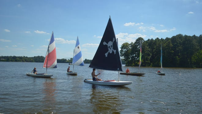 Young sailors in their Sunboats get ready for one of their races Sunday on Lake Buhlow.