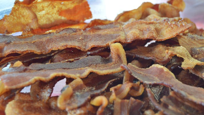 A mound of bacon, fresh off the grill, waits to be added to sandwiches at That Bacon Place.