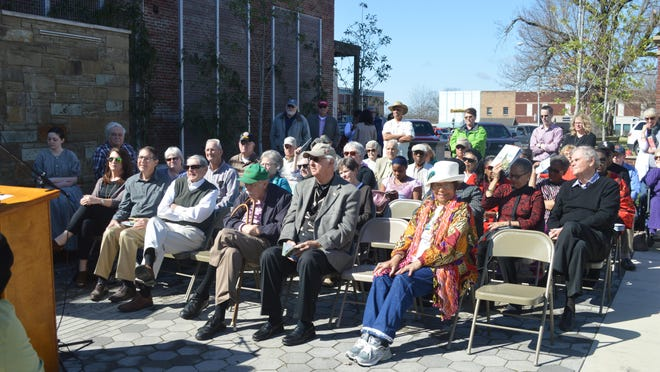 People gather Monday in Tamm Park for the dedication of two monuments honoring events that took place during the Civil War.
