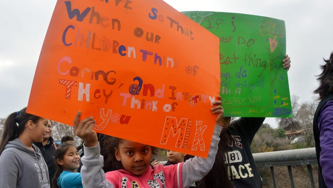 """Students chanted """"MLK,"""" waved signs and cheered throughout the streets of Visalia, Monday morning in honor of Martin Luther King Jr. Day"""