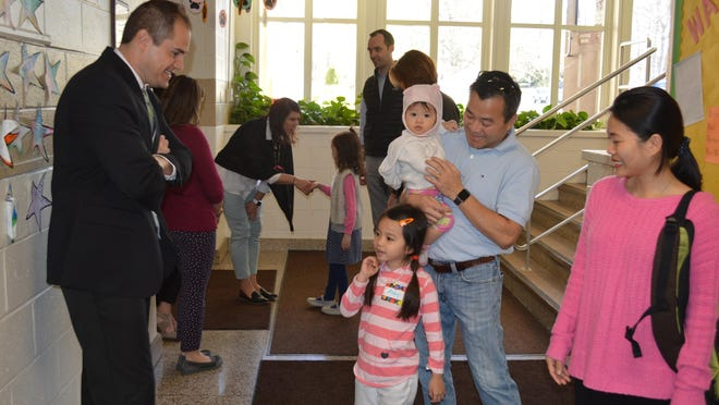 Shongum School Principal Cliff Burns welcomes the Nguyen family to Shongum School at kindergarten orientation including 5-year-old kindergartener Abby, parents Hoang and Thy and 10-month-old sister Katherine. The family recently moved to Randolph from Guam.