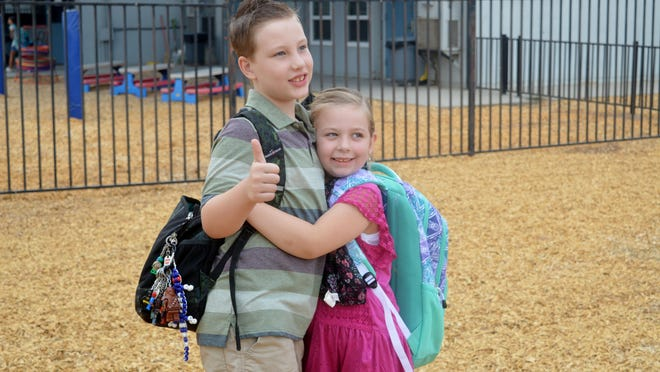 Siblings wished each other a great day as they embark on a new year of learning.