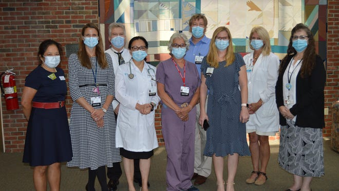 Pictured (left to right): Maureen Chung, MD, PhD, FACS - NAPBC Site reviewer; Rebecca Kwait, MD, FACS, Medical Director, Exeter Hospital Center for Breast Health; Gary Proulx, MD, Medical Director of Radiation Oncology; YongLi Ji, MD, PhD, Medical Oncology; Diane Palladino, MD, FACS Core General Surgery; Alexander Raslavicus, MD, Radiology; Jeannine Ritchie, MD, Pathology; Nancy Dargan, RN, Women's Imaging; Autumn Bridges, Coordinator of Accreditation and Registry.