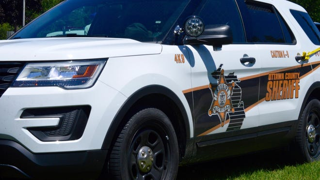 Police say a 49-year-old Holland Township woman is in custody at the Ottawa County Jail after she threatened an employee at the United Federal Credit Union on Riley Street.