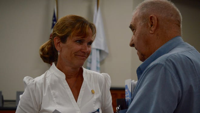 Rep. Mary Whiteford, R-Casco Township, speaks with a constituent in Holland, Mich. after a town hall in Aug. 2019.