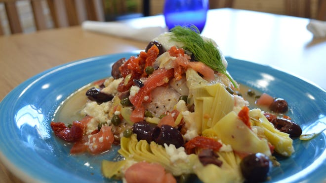 The Mediterranean seared grouper is a Hot Dish at Island Café on the Bay.